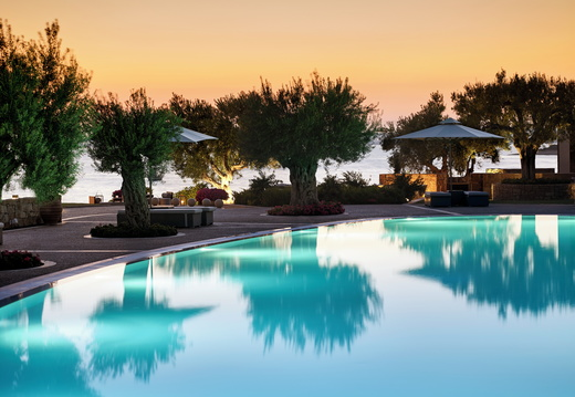 Ikos Olivia | Deluxe Collection Pool - Evening